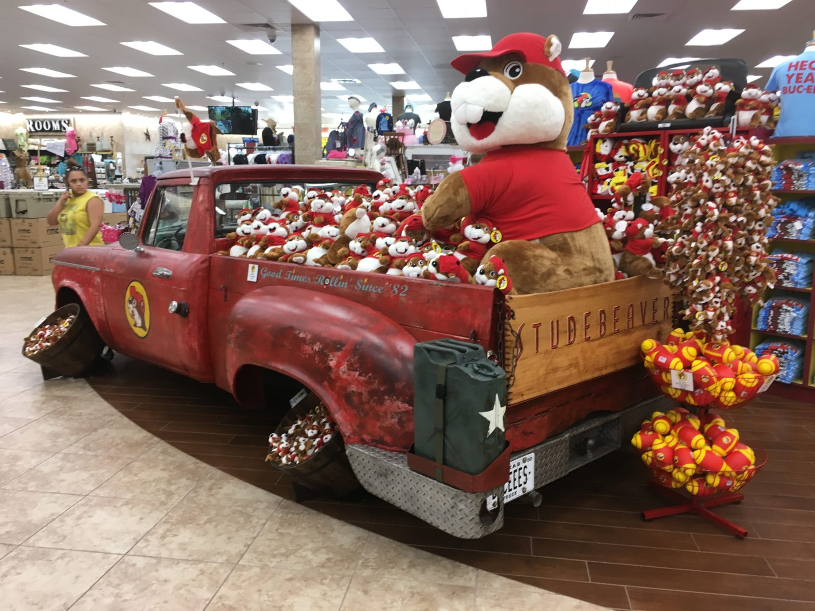 A pickup truck full of Buc-ee's merchandise.