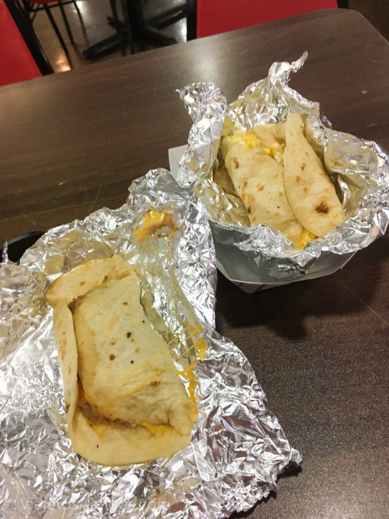 A breakfast burrito, and a rice & bean burrito.